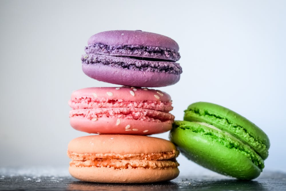 a pink, green, purple and orange macaroons for Effects of Natural and Artificial Sweeteners on your Body